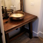 Walnut face grain reproduction wood vanity top and base.  Distressed with Waterlox Satin finish.